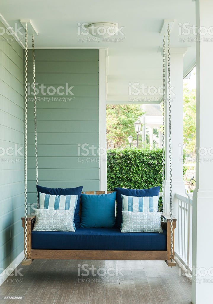vintage swing and blue pillow stock photo