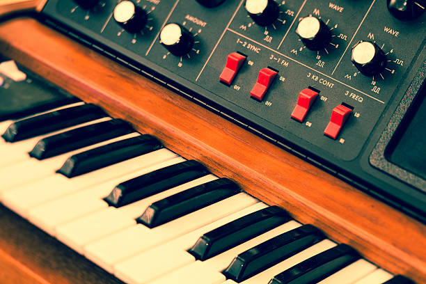 Vintage synthesizer keyboard musical instrument Abstract toned image of vintage synthesizer keyboard musical instrument. Selective focus and tilt. synthesizer stock pictures, royalty-free photos & images
