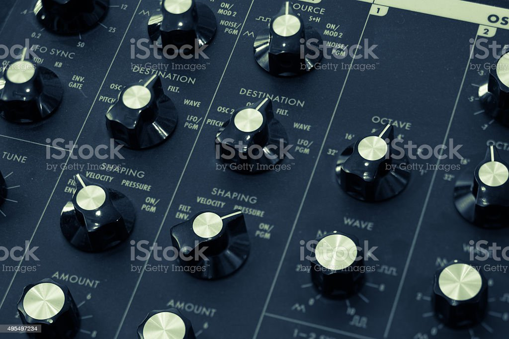 Vintage synthesizer musical instrument knobs and controls stock photo
