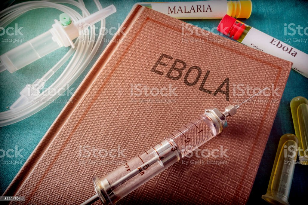 Vintage Syringe On A Book Of Ebola, Medical Concept stock photo