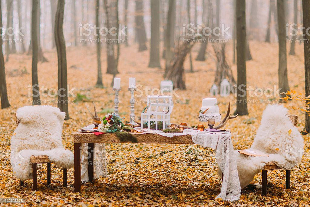 Vintage table decorated in scandinavian style on the autumn woods stock photo