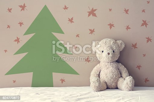 istock vintage teddy bear sit on the right side white bed 624770872