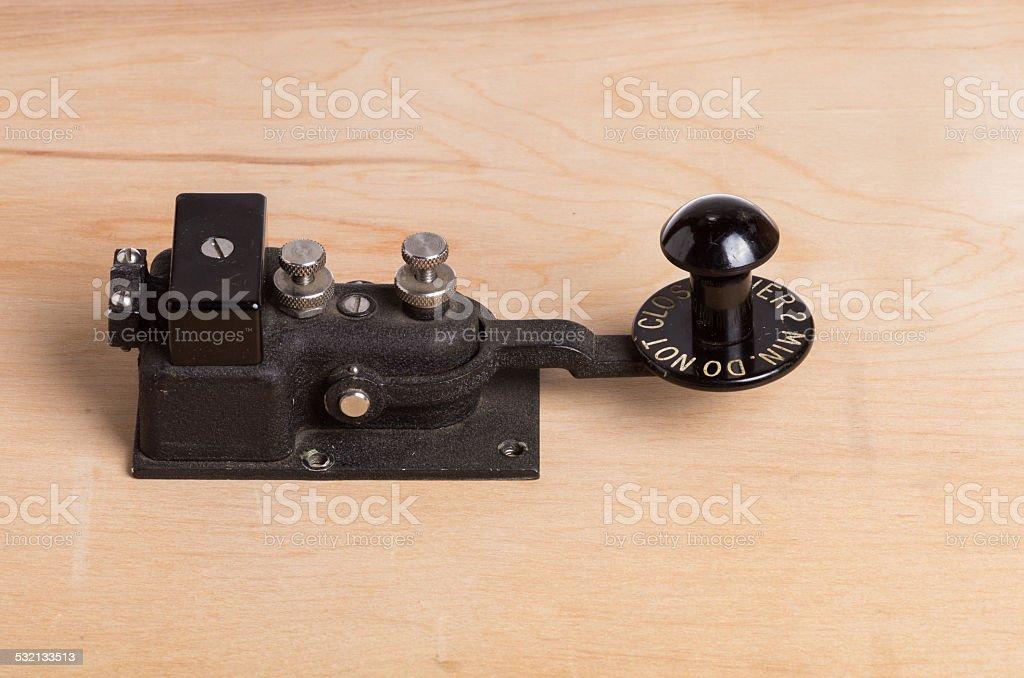 Vintage telegraph key on desk stock photo