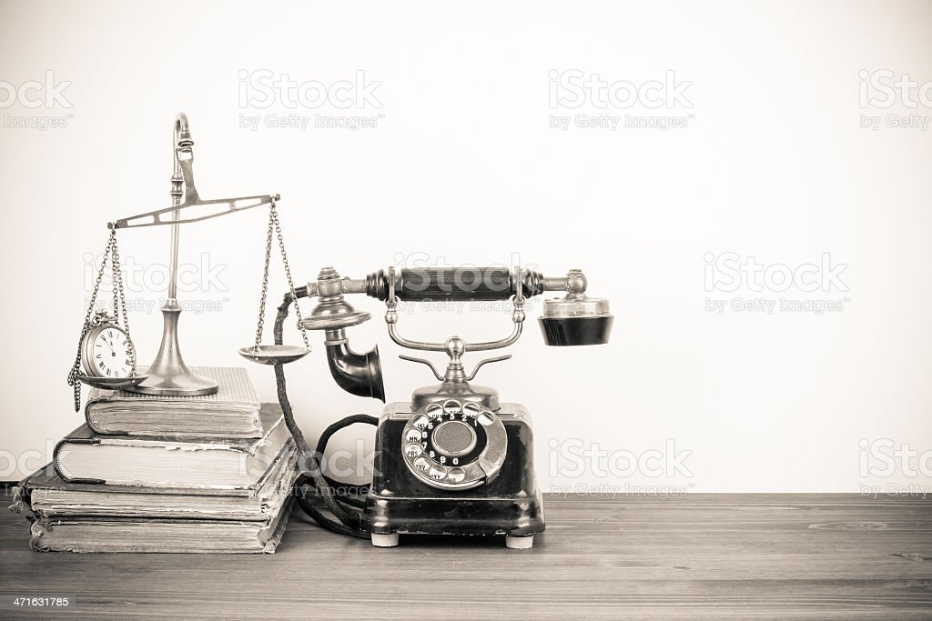 Vintage telephone, scales with pocket watches, books old style photo royalty-free stock photo