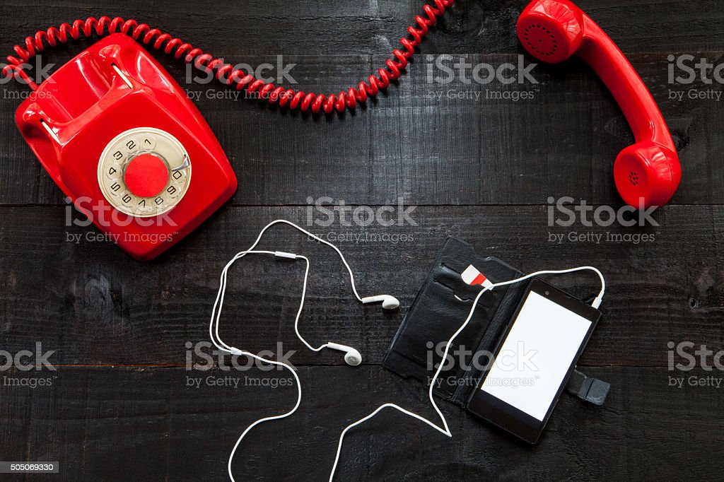 Vintage telephone vs smartphone stock photo