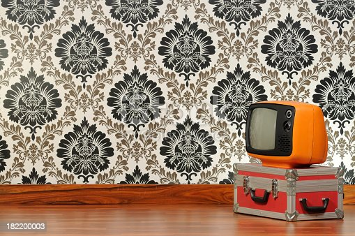181053292istockphoto Vintage television in front of a Damascus wallpaper 182200003
