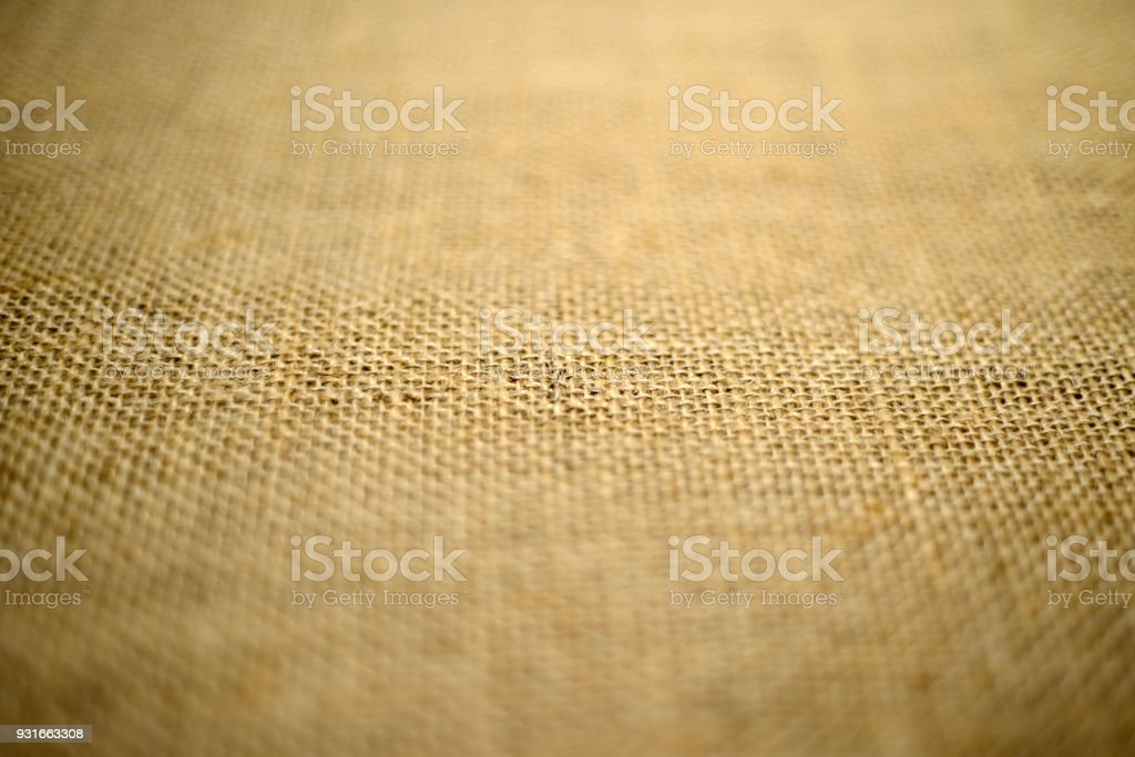 vintage textured background of coarse burlap, small depth of field stock photo