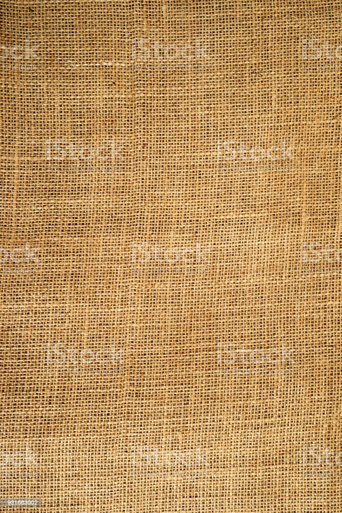 vintage textured background of coarse burlap, vertical stock photo