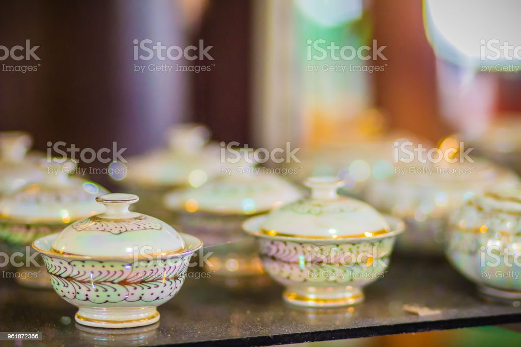 Vintage Thai's style handmade porcelain tea cups set. Beautiful traditional Thai five-colored porcelain ceramic tea cup set. Benjarong Porcelain tea cups for sale in the flea market, Thailand. royalty-free stock photo