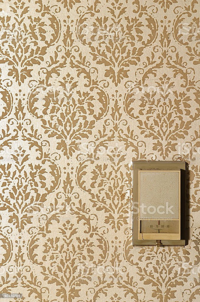 vintage thermostat on wallpaper royalty-free stock photo