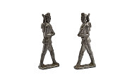 Old tin soldier on a white background. Two tin soldiers
