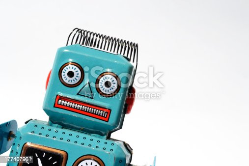 Portrait of a vintage tin toy robot isolated on white background.
