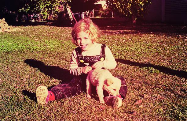 Vintage toddler with a puppy picture id929063400?b=1&k=6&m=929063400&s=612x612&w=0&h=iind00mvkjqecolzlsf5tc3r kcwvc2b8yfgw7xmoey=