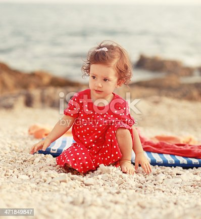 147878016 istock photo vintage toned baby girl playing at the beach 471849847