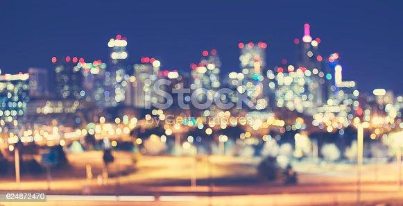 istock Vintage toned blurred Denver city lights at night. 624872470