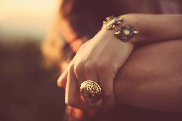 vintage toned cross processed hand with jewelry - hand gold jewels bildbanksfoton och bilder