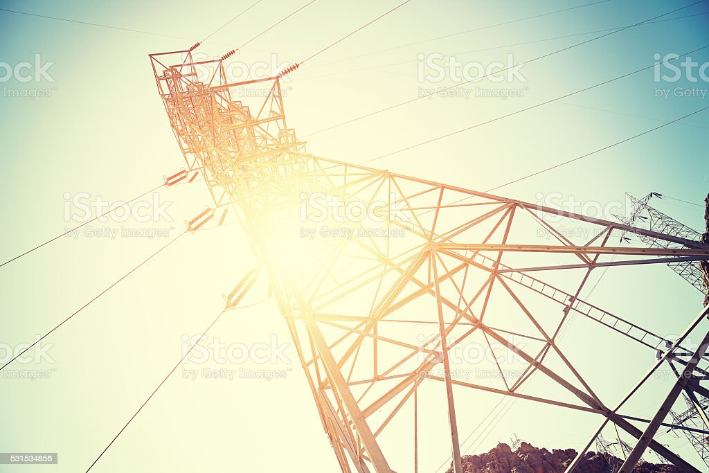 Vintage toned electricity transmission tower. stock photo