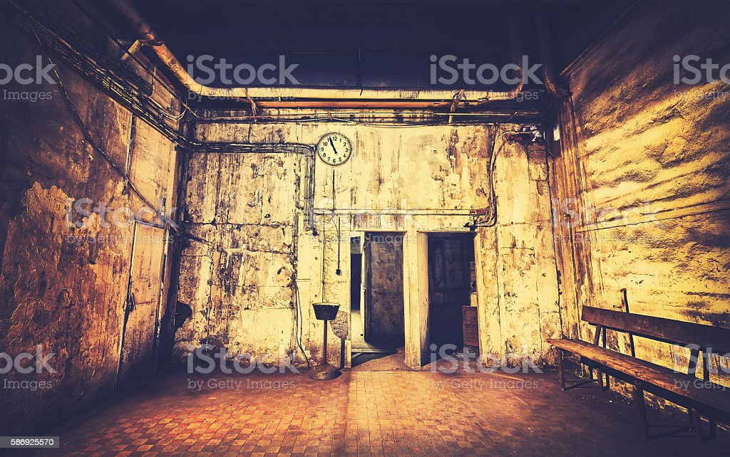 Vintage toned grunge interior with clock on a wall. stock photo