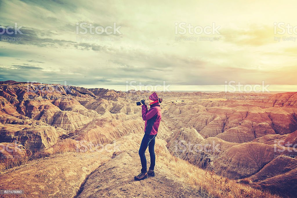 Vintage toned photo of a female photographer taking pictures at stock photo