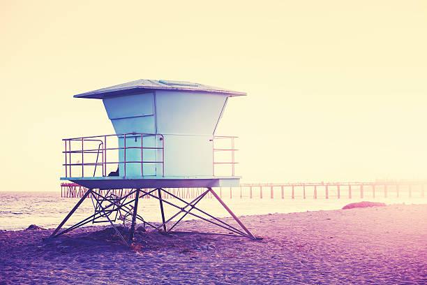 vintage toned picture of a lifeguard tower at sunset. - badvaktshytt bildbanksfoton och bilder