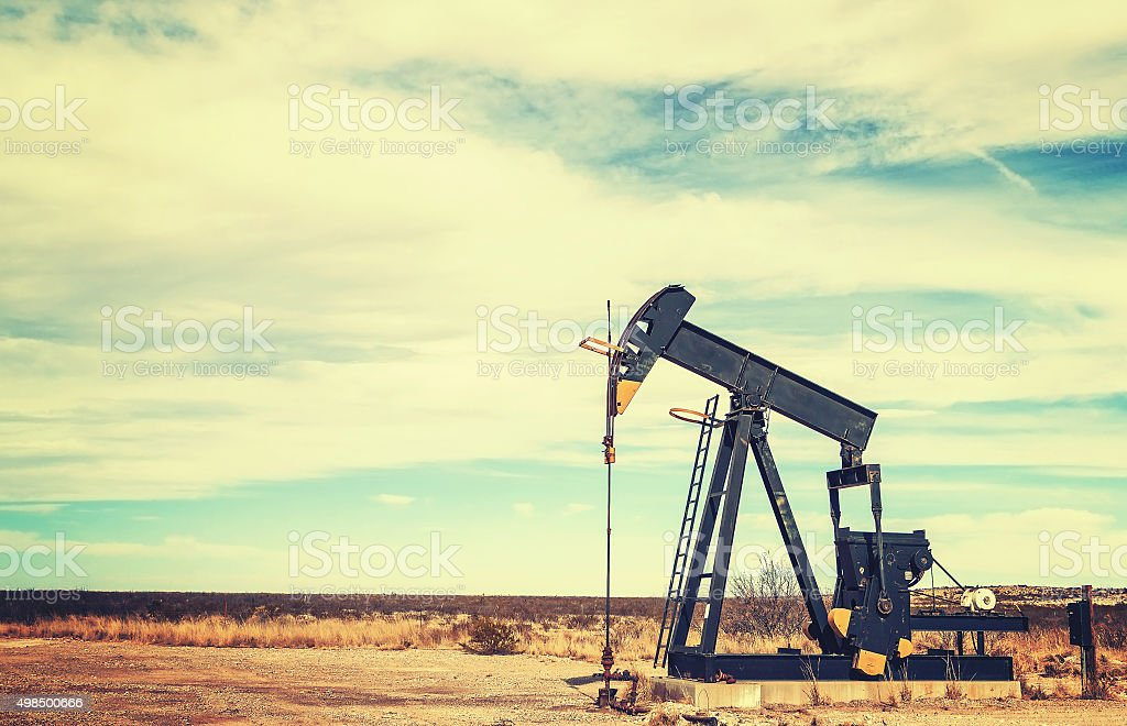 Vintage toned picture of an oil pump jack, Texas. stock photo