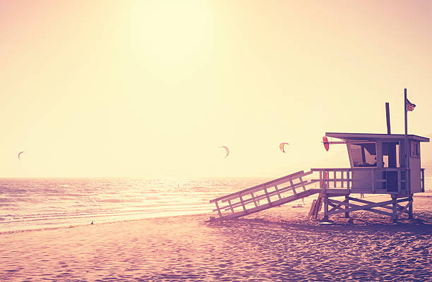 Vintage toned picture of lifeguard tower at sunset, Malibu. stock photo