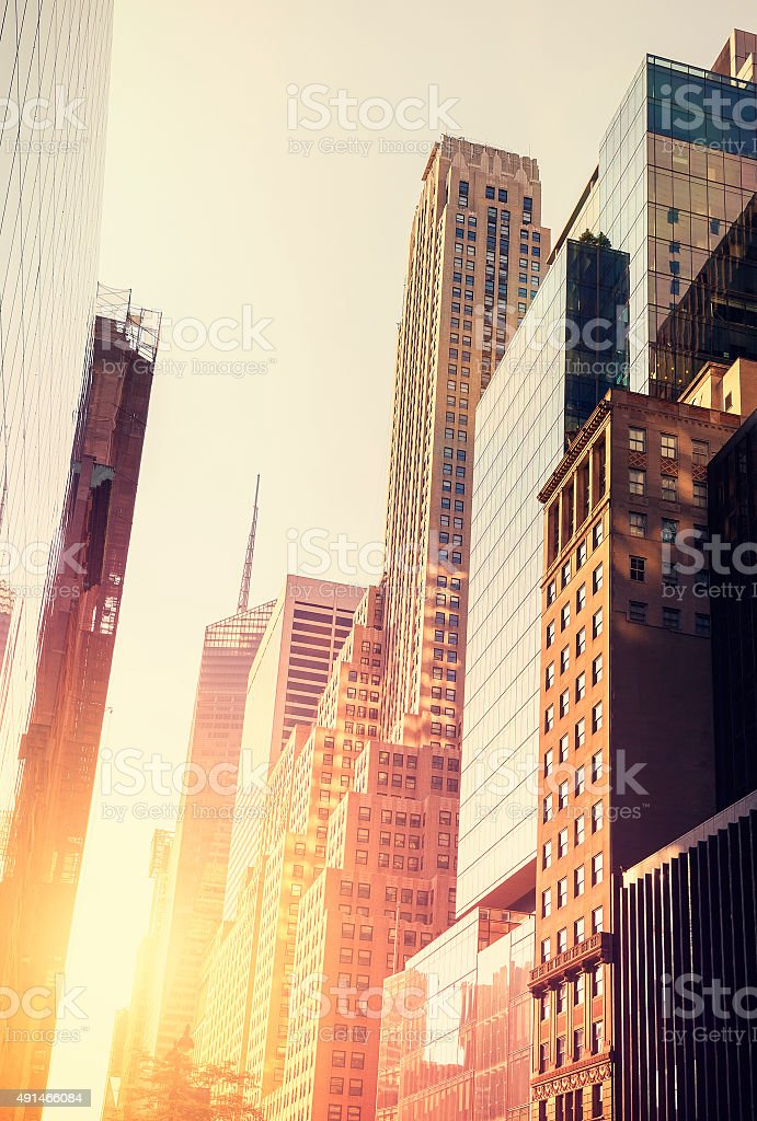 Vintage toned picture of Manhattan at sunset, New York, USA. stock photo