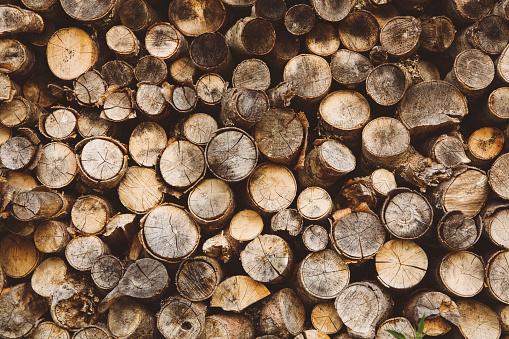Vintage toned pile of logs