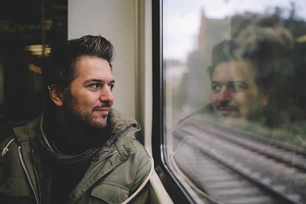 vintage toned portrait of  a man in berlin metro train - subway foto e immagini stock