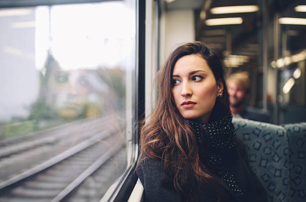 vintage toned portrait of  a woman in berlin metro train - subway foto e immagini stock
