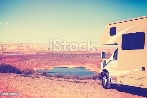 Vintage toned RV (camper) parked by canyon, family vacation concept, Lake Powell, USA.