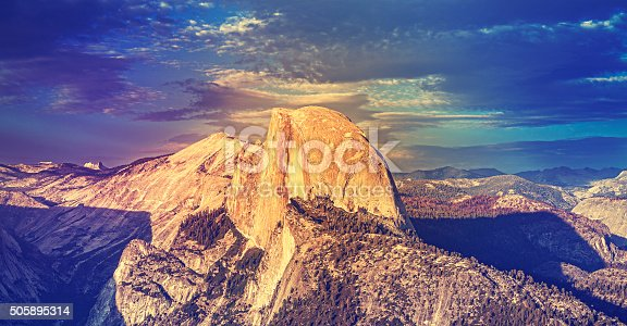 Vintage toned sunset above Half Dome rock in Yosemite National Park, USA.