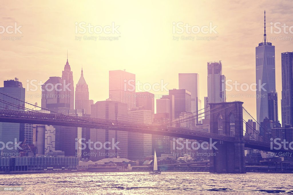 Vintage toned sunset over Manhattan and Brooklyn Bridge, NYC. stock photo