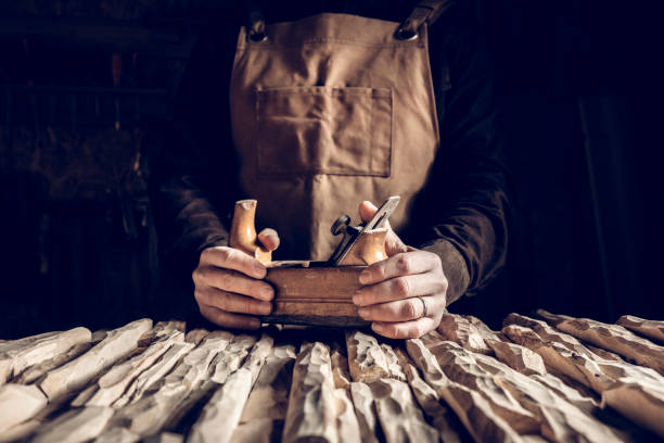 vintage tools background detail of hands holding vintage hand planer carving craft product stock pictures, royalty-free photos & images