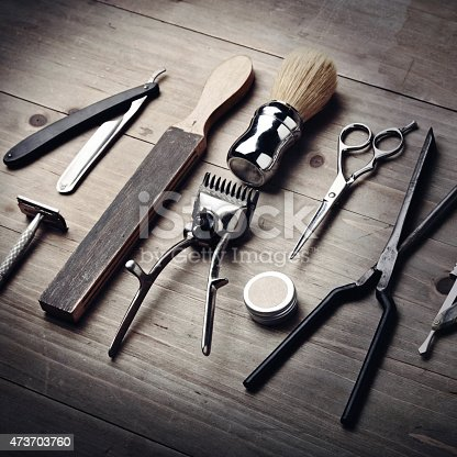 istock Vintage tools of a barber on wood desk 473703760