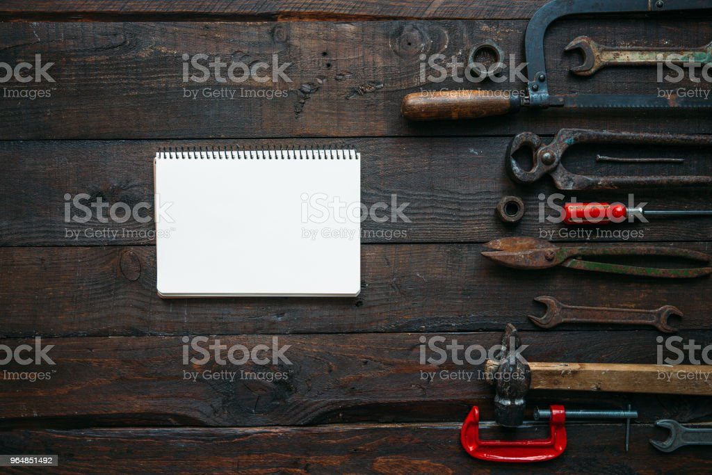 Vintage tools set on dark brown wooden background royalty-free stock photo