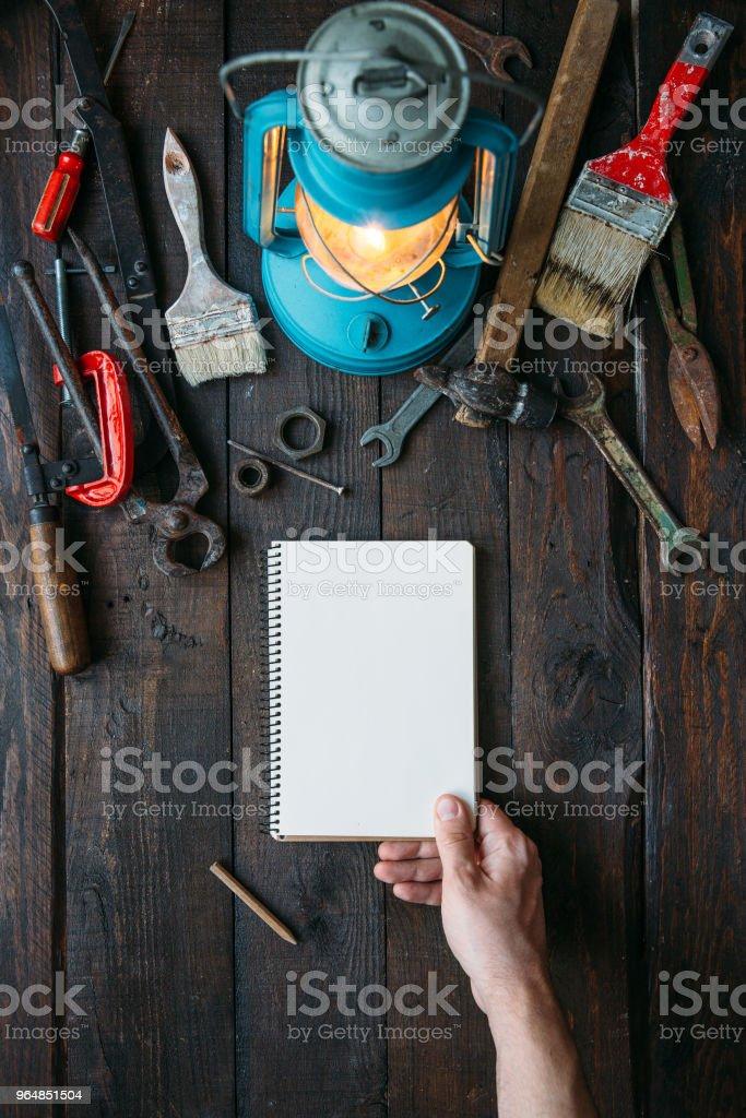Vintage tools set on dark brown wooden background royalty-free stock photo