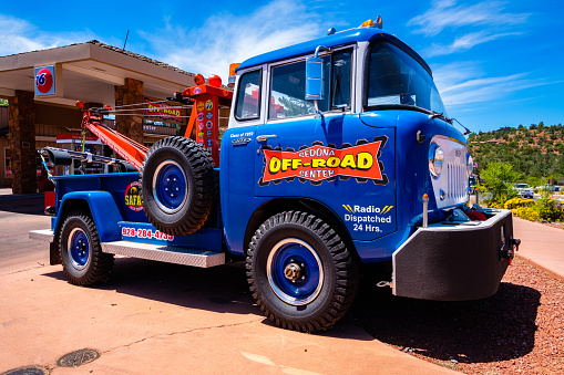 Sedona, Arizona USA - May 2, 2017: Vintage colorful 1959 tow truck parked along highway 89 in this popular small tourist town.