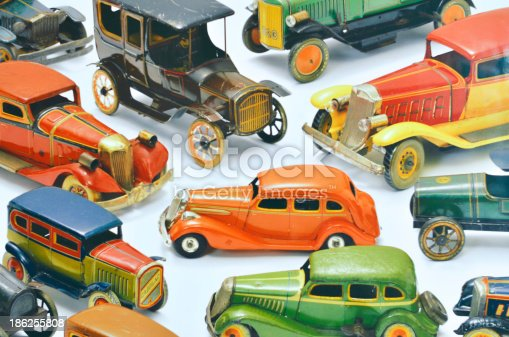 Antique old vintage toy cars isolated on white