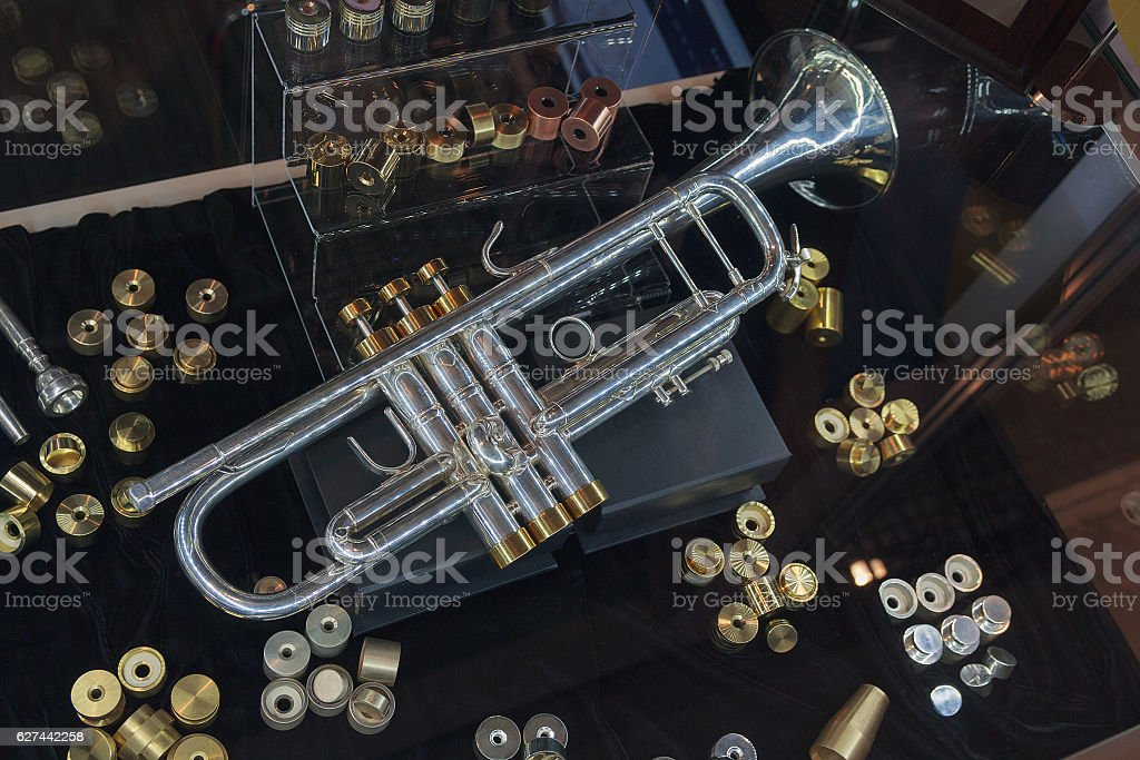 Vintage toy trumpets at market. Musical instruments stock photo