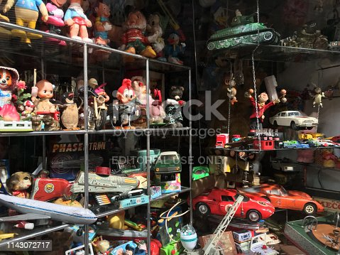 Buenos Aires, Argentina - April 7, 2019: Lots of antique and vintage toys displayed in toy store window. This one is located in San Telmo's market, a place where lots of antique stores are located and locals and tourists visit alike
