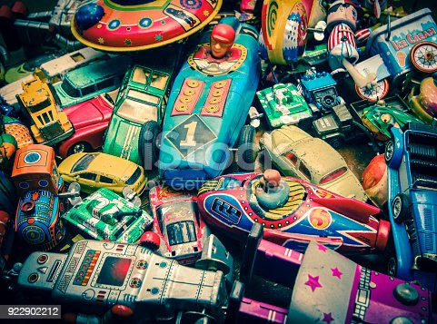 lots of vintage toys on a wooden floor