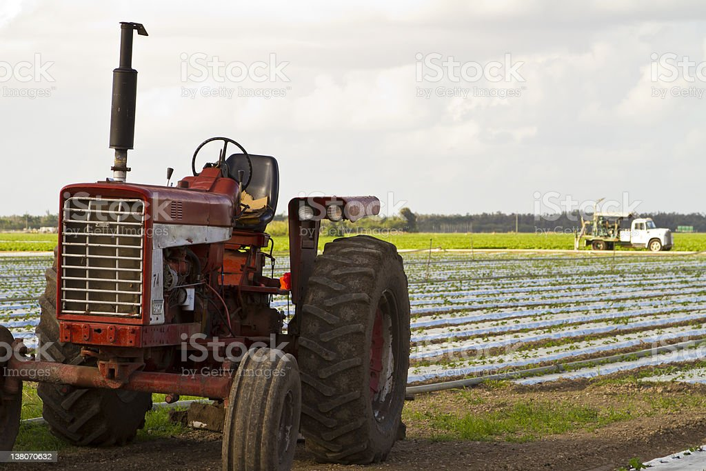 vintage tractor on cultivated farmland royalty-free stock photo
