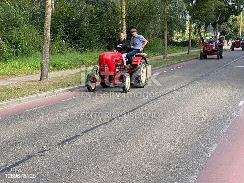Brunssum, the Netherlands, - August 30, 2020. Vintage tractors moving on during a cultural festival In the country.