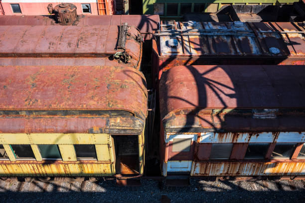 vintage train cars and locomotives, covered in rust and are in disrepair, rest on tracks in scranton, pa, usa. - scranton pa stock photos and pictures