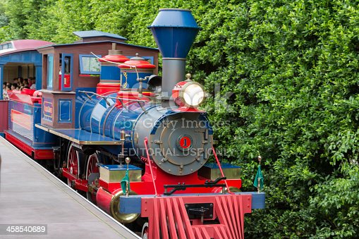 Hong Kong, Сhina - September 2, 2013: Tourists take the vintage train at Hong Kong Disneyland to circle around the theme park.