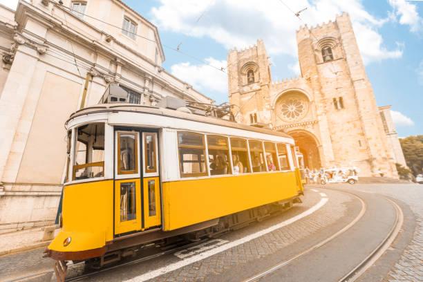 vintage tram transportation in lisbon city portugal - lisbona foto e immagini stock