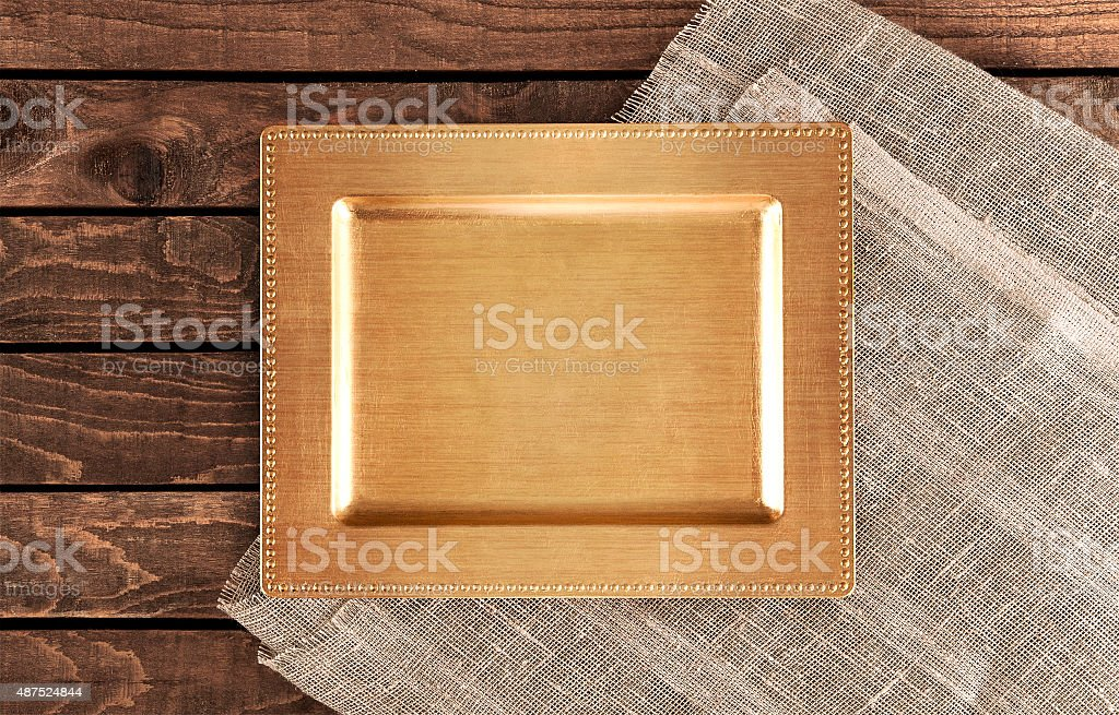 Vintage tray on a wooden table. top view