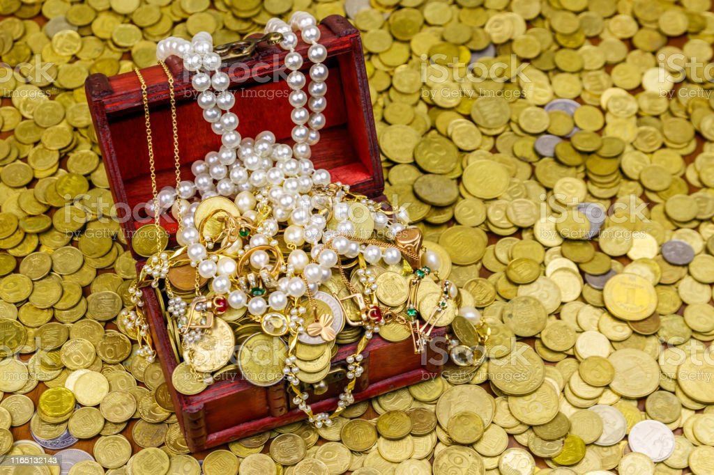Vintage treasure chest full of gold coins and jewelry on a background...