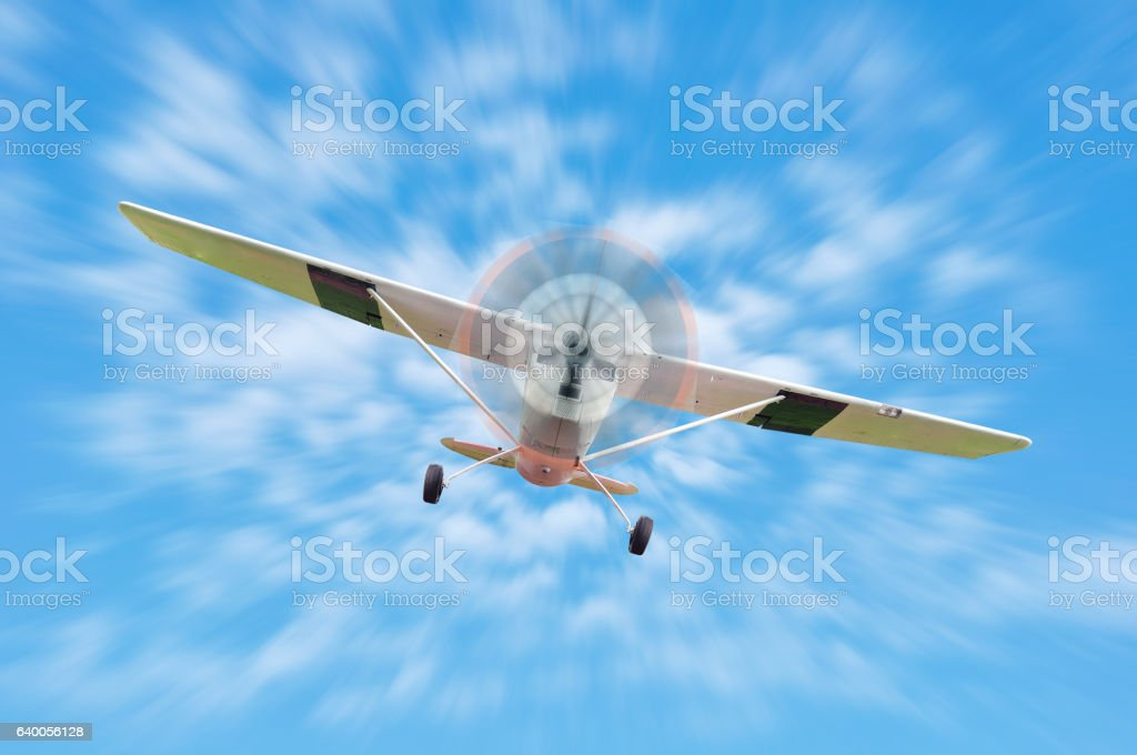 Vintage turboprop airplane flying straight at the camera. stock photo